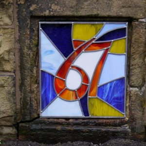 Stained glass house numbers Opaque glass number, multi coloured background
