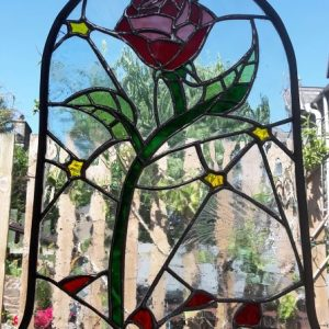 Bespoke stained glass rose Red Rose from Beauty and the beast in a bell jar, green leaves and step, yellow stars and red petals on the ground