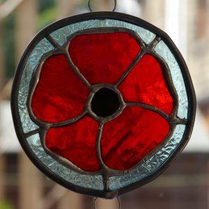 red poppy round suncatcher red petals, blue background