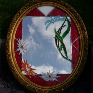 wooden gilt framed mirror, red border, white and orange flowers, green grassy leaves and turquoise dragon fly