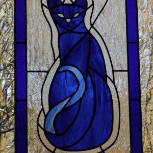 Bespoke stained glass cat panel, clear textured background, different textured clear border, royal blue border, cat and inset wedges