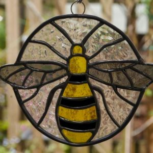Stained Glass Bee yellow black and grey bee, clear background. Round