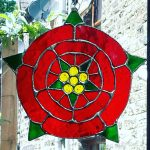 Lancashire red rose, green leaves, yellow stamens and green inner leaves