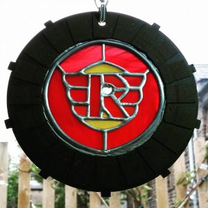 Royal Enfield logo, red with yellow accents made from Clutch plate