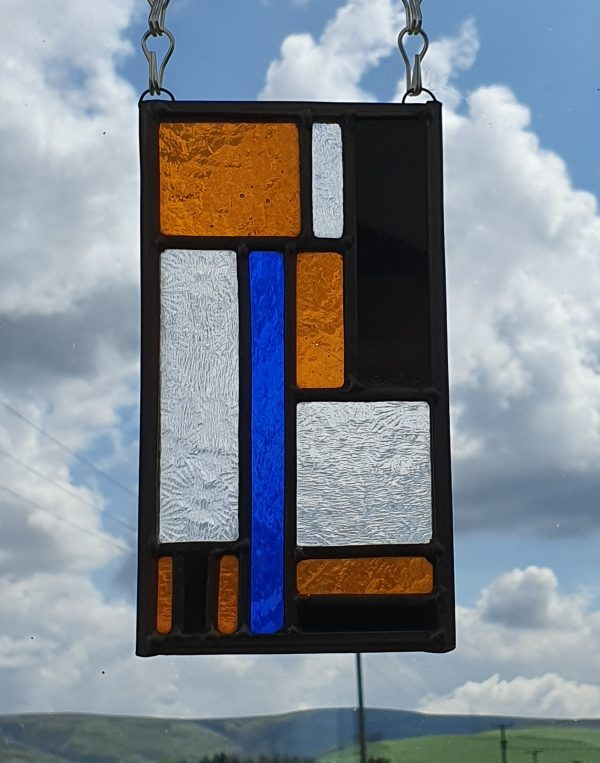 Mondrian style Harley colours, orange, clear, blue and black rectangle
