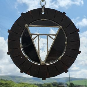 https://wwwStained Glass Triumph suncatcher clear T and black background