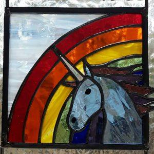 Pale blue unicorn with rainbow